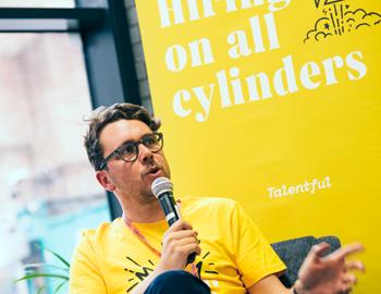 man speaking at talentful talks event