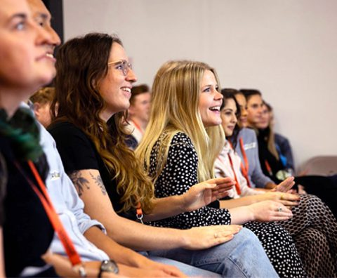 Photo of a group of Talentful employees at a conference